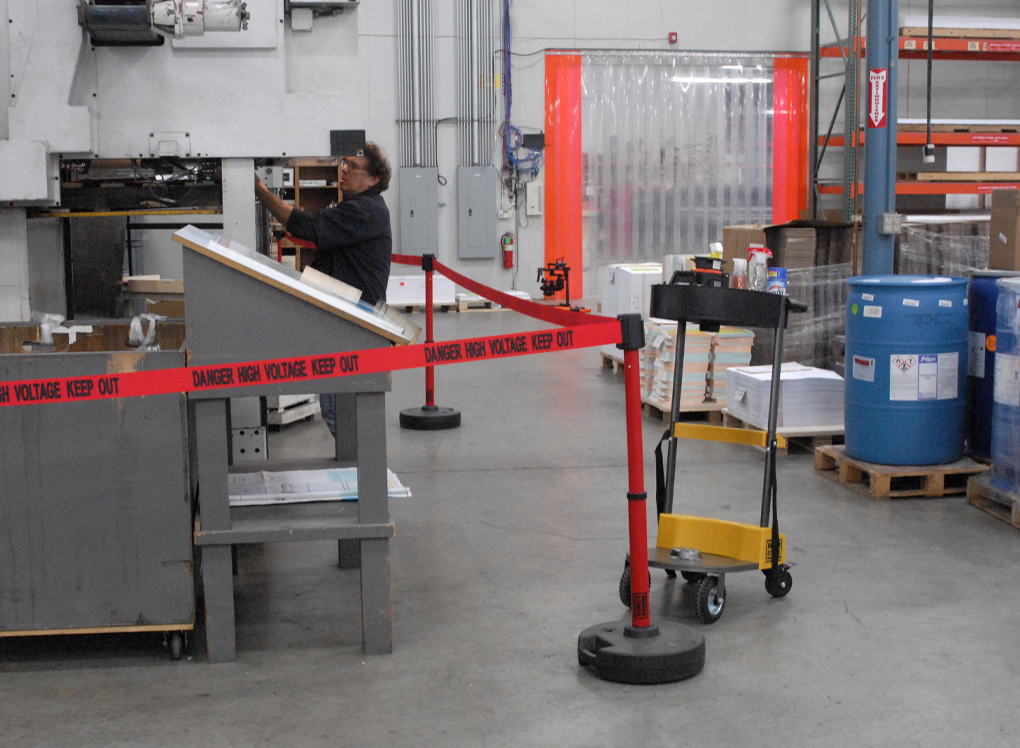 image of safety barrier dividing space in warehouse