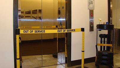 image of safety barrier blocking broken elevator
