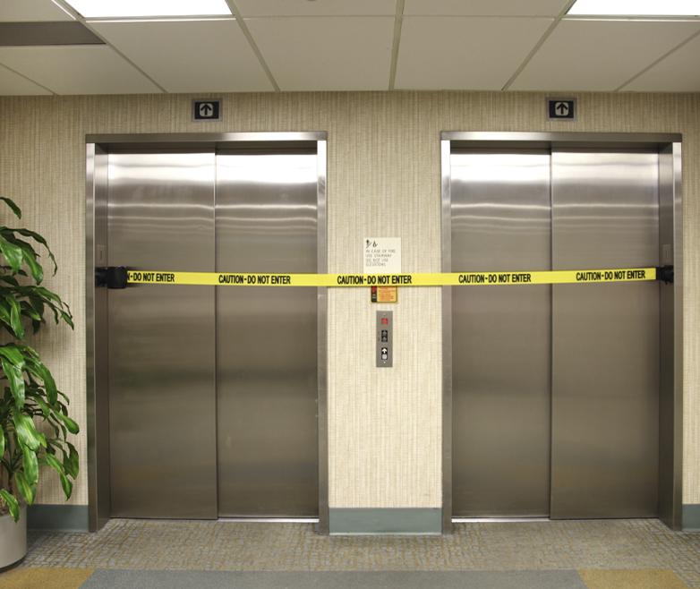 image of barrier closing elevators